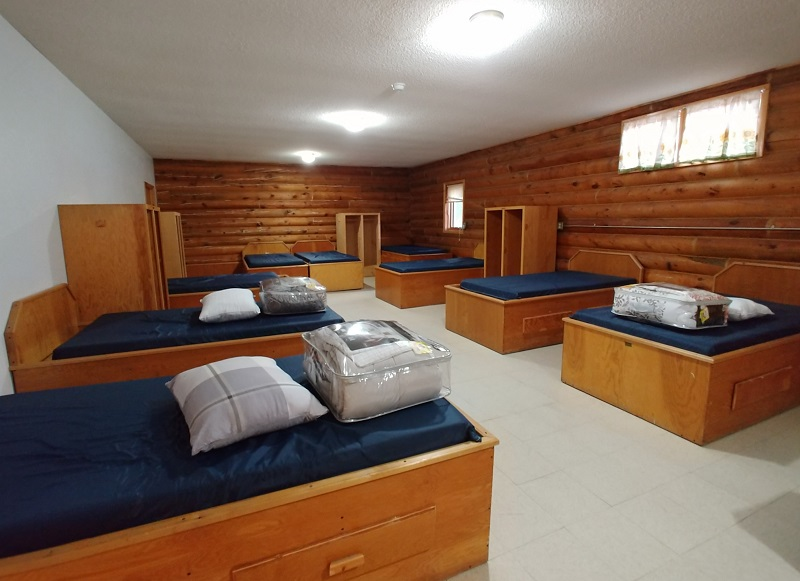 Bunkhouses for students. Bathrooms and showers are adjacent to the sleeping area.