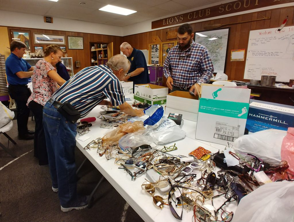 Noon Lions Club members sorting donated eyeglasses